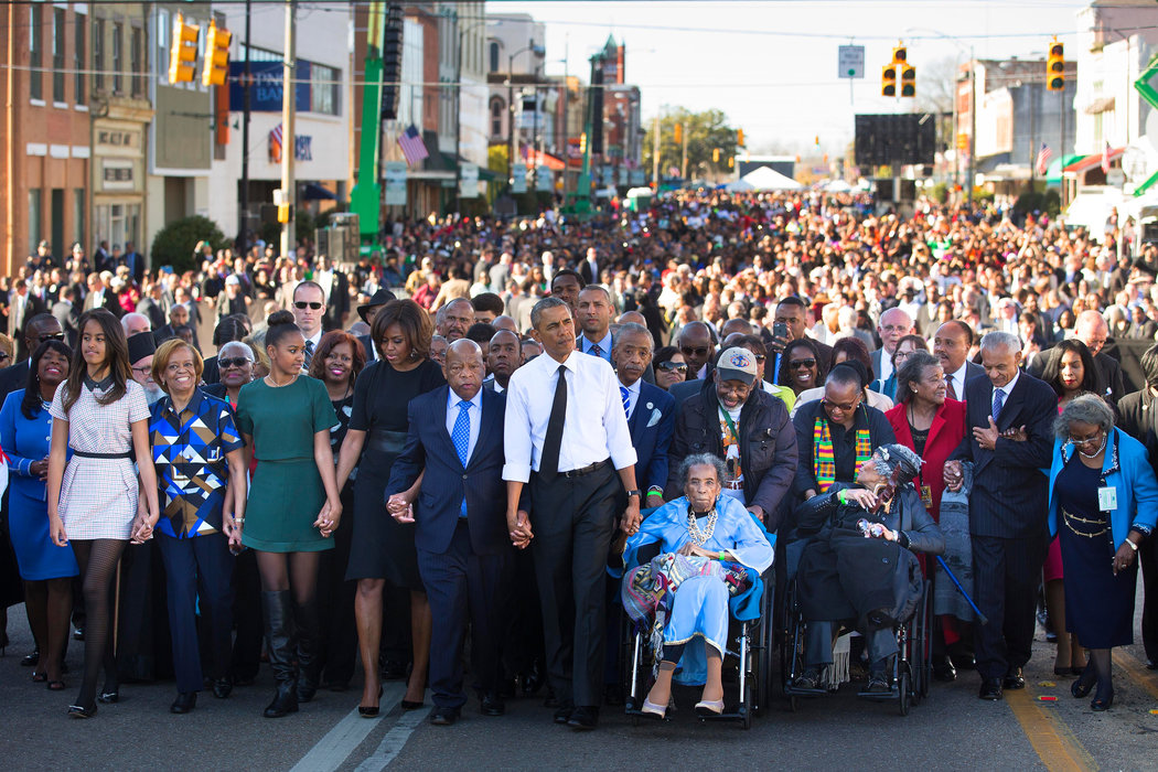 """via  NY Times     The March on Selma   50 years after peaceful protesters in Selma, AL were beaten by police officers, leading to the passage of the Voting Rights Act of 1965, Obama led a huge bipartisan march to commemorate those who fought and paved the way for the next generation. Also, with the all the other current events happening at the time, it was more important than ever to push on and remind folks that """"BLACK LIVES MATTER."""""""