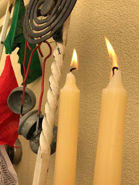 candles on sculpture.jpeg