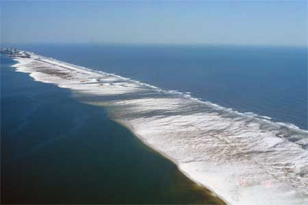 The narrow barrier island was breached by Ivan.
