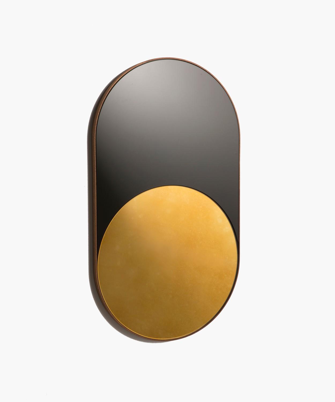 - BowerCylinder Mirror2019Black & antique gold glass, walnut36 1/2 x 20 1/2 x 1 inch