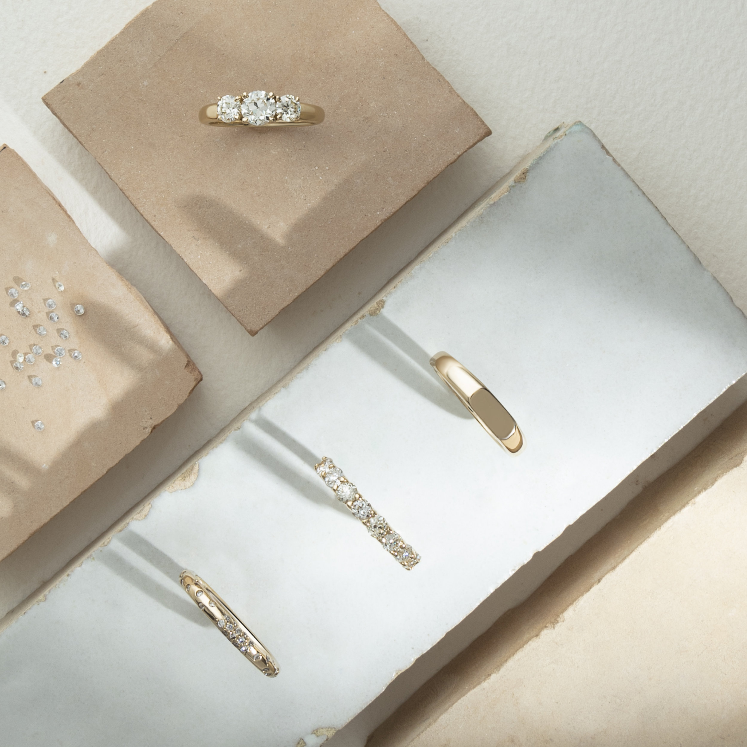 MINIMAL - Minimal and refined, low-key romance anchored in classic design.Appealing to the minimalist aesthete, sculptures of solid, recycled gold set the tone for the collection. Geometric design so simple it feels classic, while the twist, a personal edit of responsibly sourced, hand-cut, and reclaimed fine gems are accented by an asymmetric wash of pavé diamonds that capture and reflect light.— sure to catch only the good sort of attention.