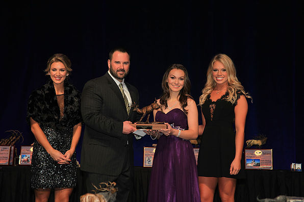 Emily receiving her 2016 Young Hunter of the Year Award at the SCI Convention in Las Vegas