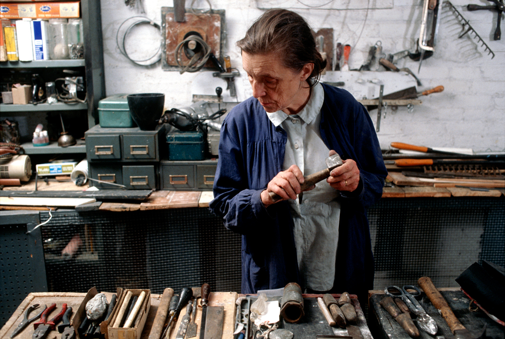 Louise Bourgeois in her home studio in 1974. Photo: Mark Setteducati, © The Easton Foundation   Header Image:  Louise Bourgeois TWOSOME, 1991 Steel, paint and electric light 190.5 x 193 x 1244.6 cm. Collection The Easton Foundation Photo: Peter Bellamy, © The Easton Foundation/ Licensed by VAGA, NY