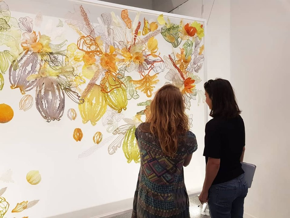 Jenna Romano (right) with artist Sivan Pais in front of her work