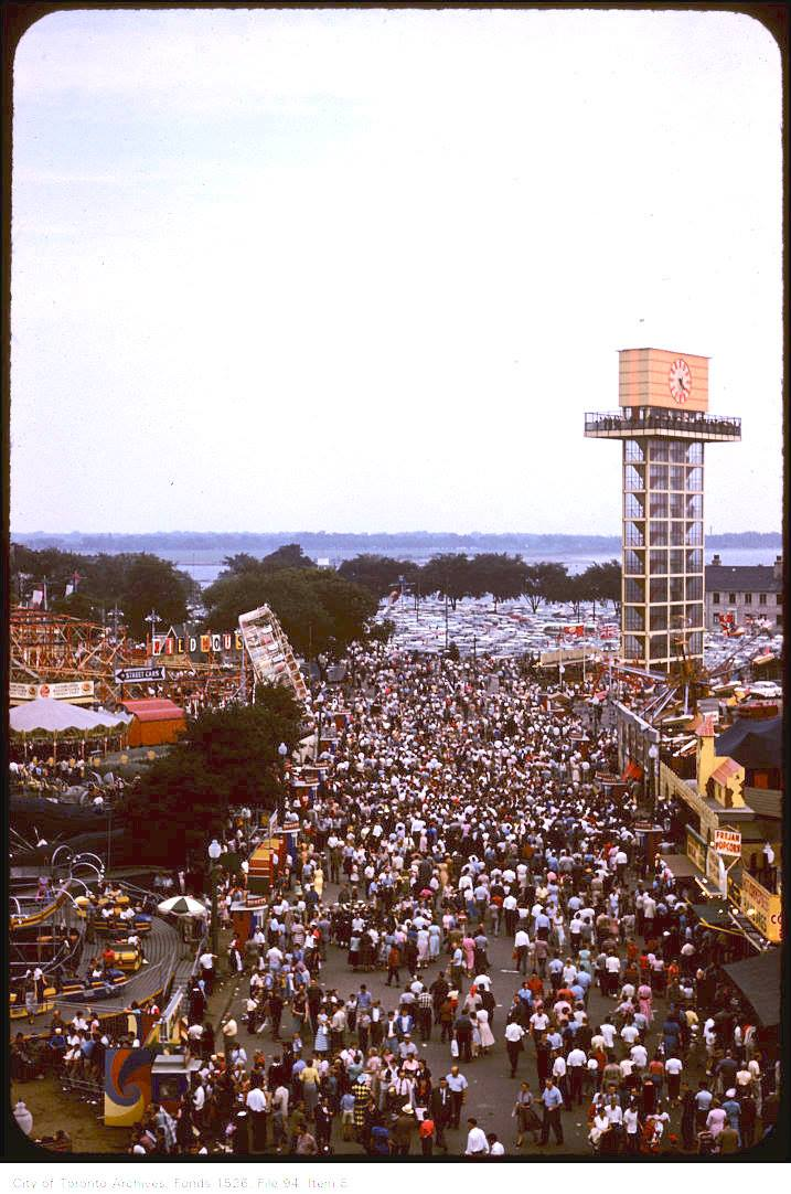 Slight overhead view of crowds on CNE grounds and new Shell oil tower – September 6, 1958  Creator: Harvey R. Naylor Date: September 6, 1958 Archival Citation: Fonds 1526, File 94, Item 8  Credit: City of Toronto Archives  www.toronto.ca/archives   Copyright was transferred to the City of Toronto by the copyright owner.