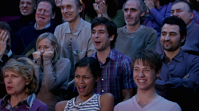 People laughing during a horror movie