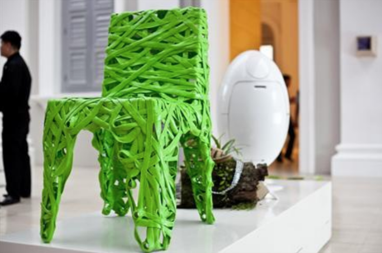 Qi-global-launch-green-chair.png