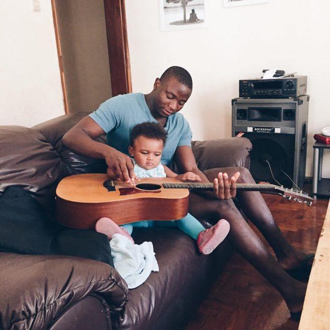 Neddy and Maya Faye playing guitar