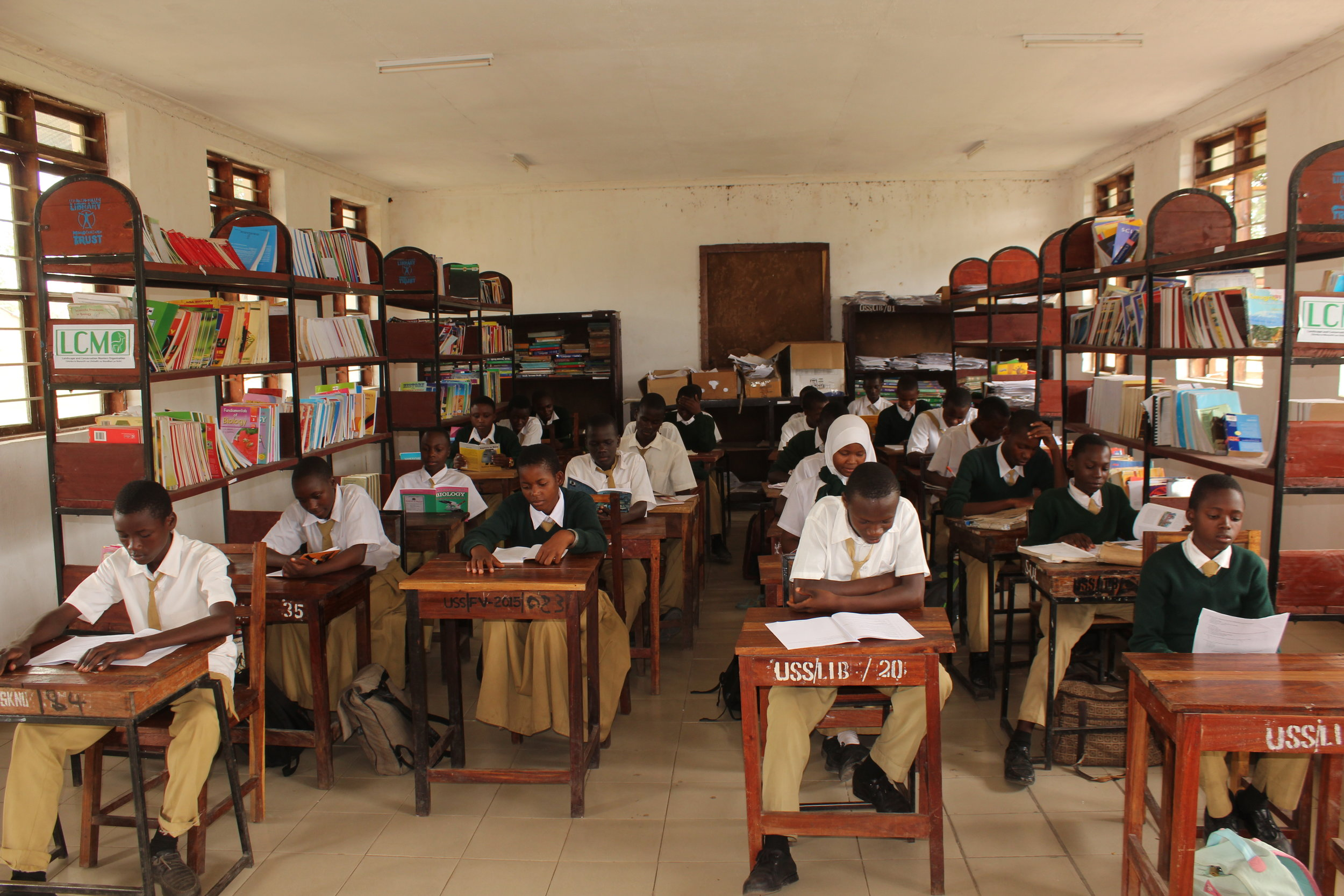 Students from Usevya Secondary school studying in the newly equipped library.