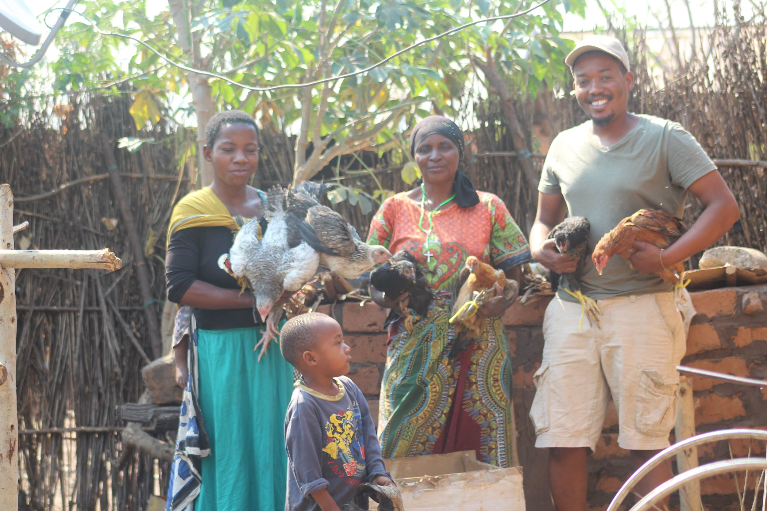 Emmanuel Stephen, project supervisor with one of the chicken beneficiaries from Usevya village.