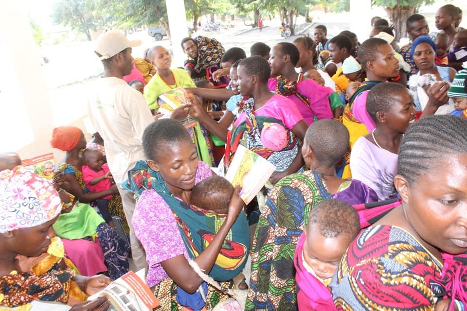 Jonathan distributing brochures to women during the Fistula education.