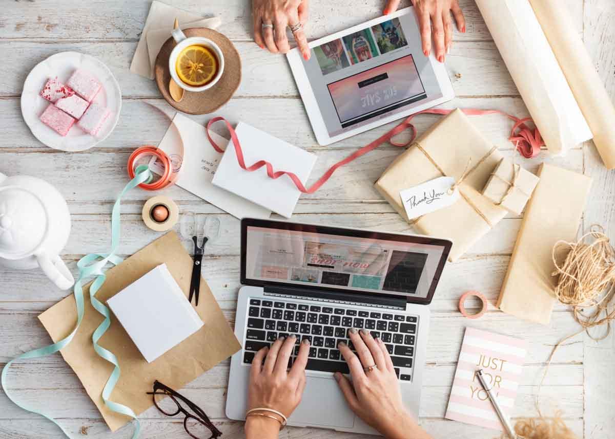 Creative entrepreneurs designing a business website