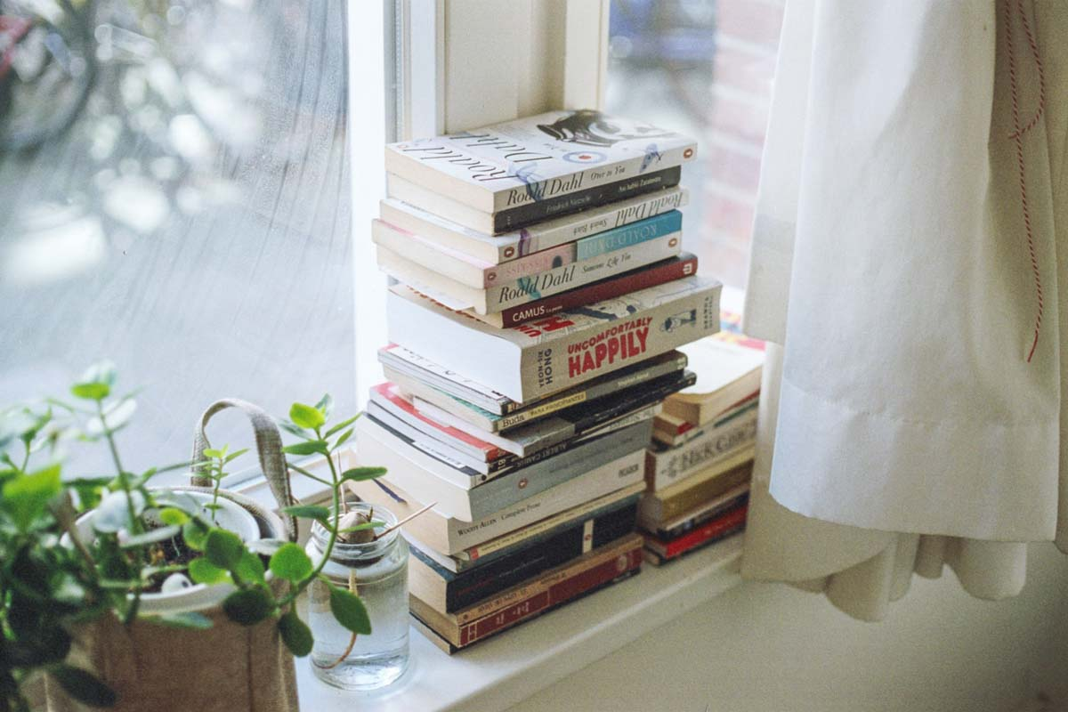 Pile of books in a cosy home