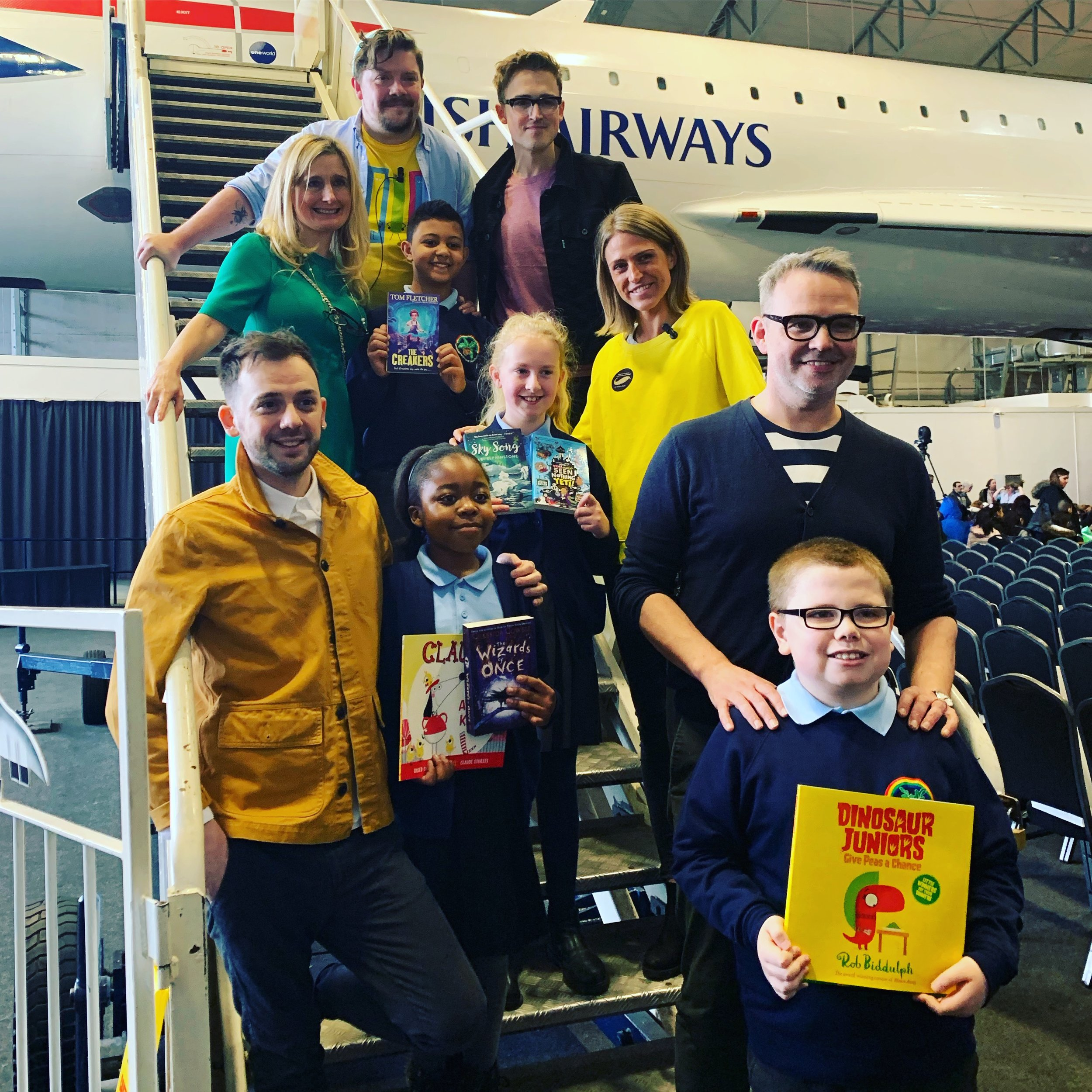With Steven Butler, Cressida Cowell, Tom Fletcher, Alex T Smith and Abi Elphinstone on the steps of Concorde at our WBD event in Manchester.
