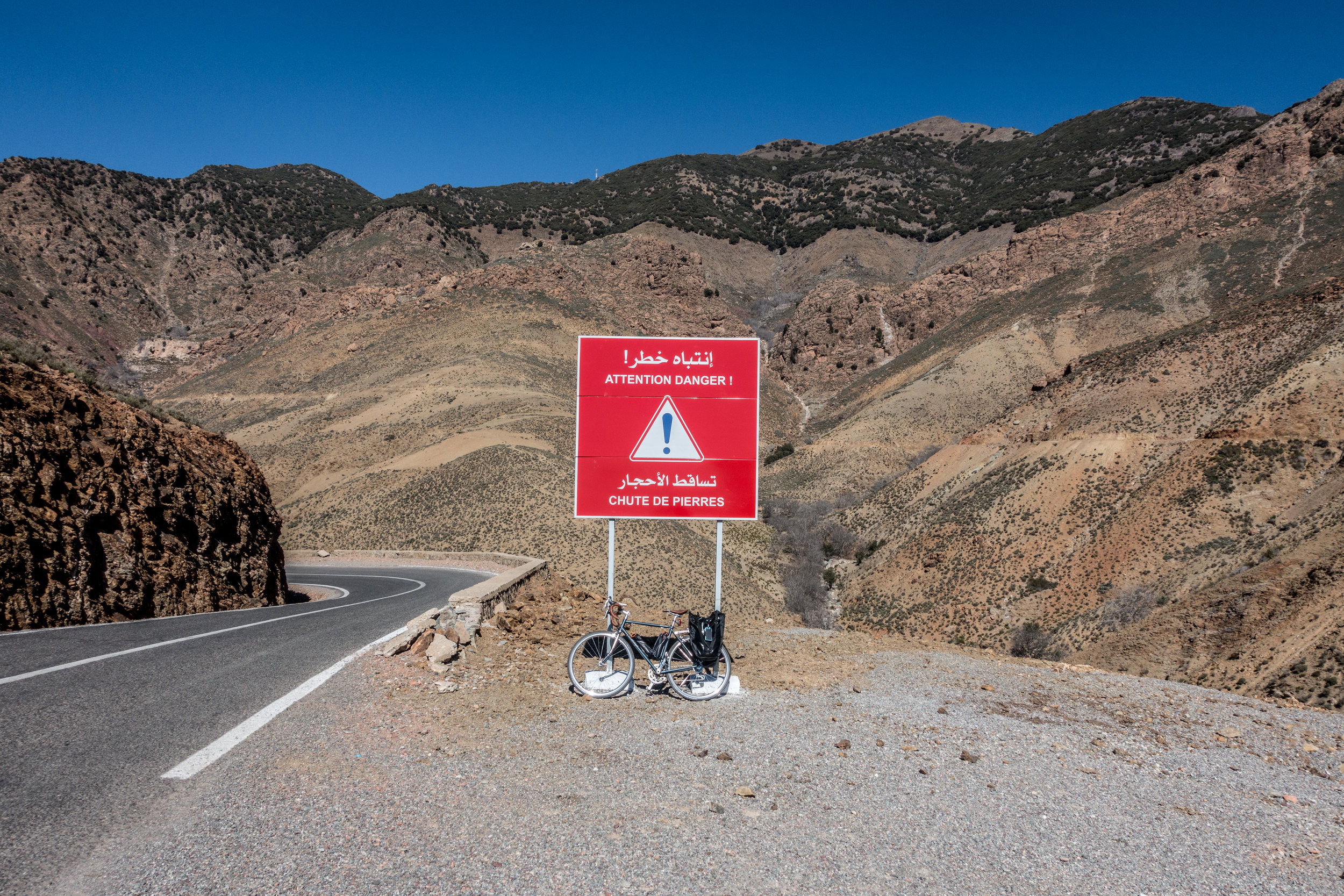 Surviving the hairpin descent of Morocco's Atlas Mountains without incident or injury.