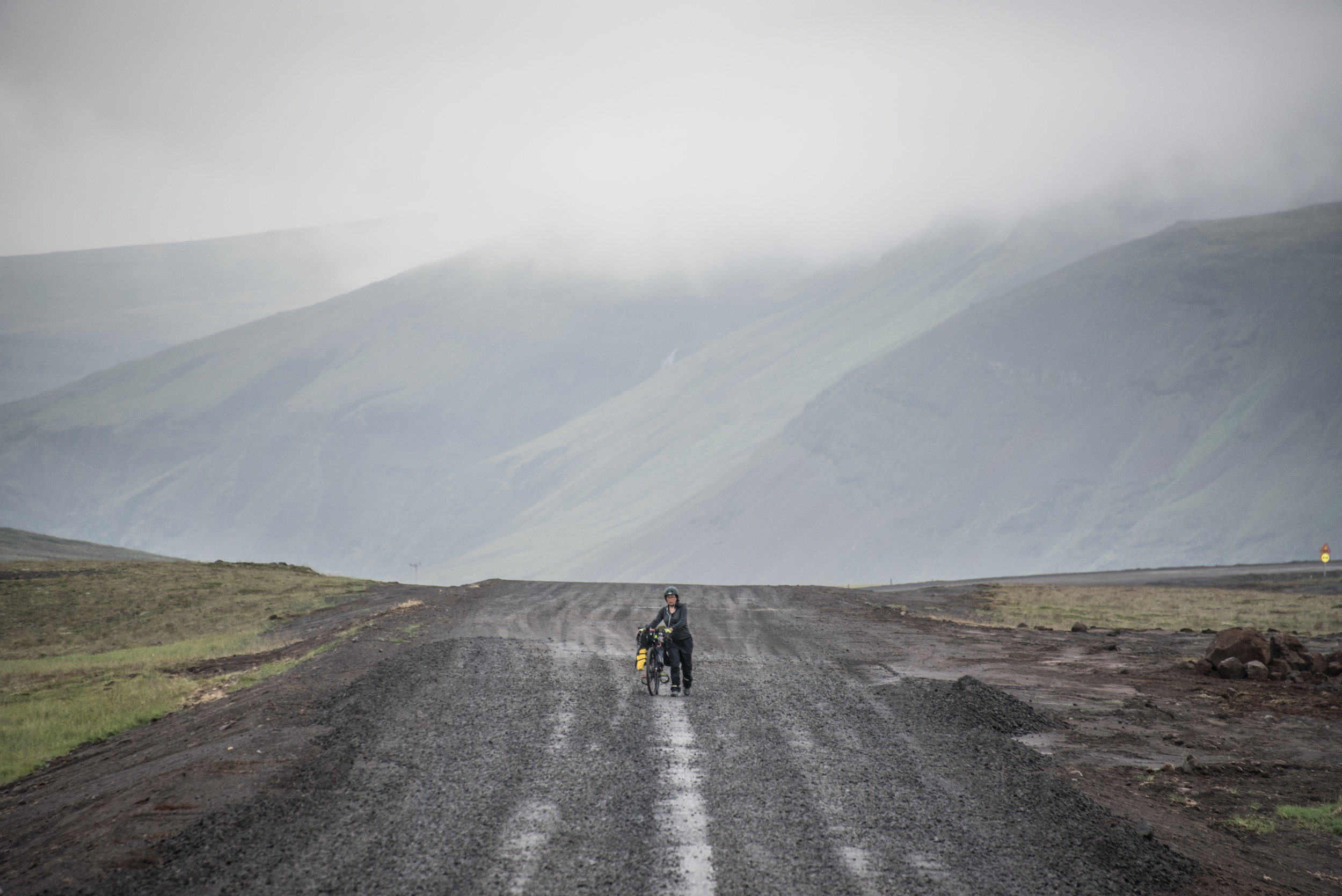 An awful ride (and eventually walk) along a wet, cold, hilly, gravelly road in Iceland that pushed us to our emotional limits.