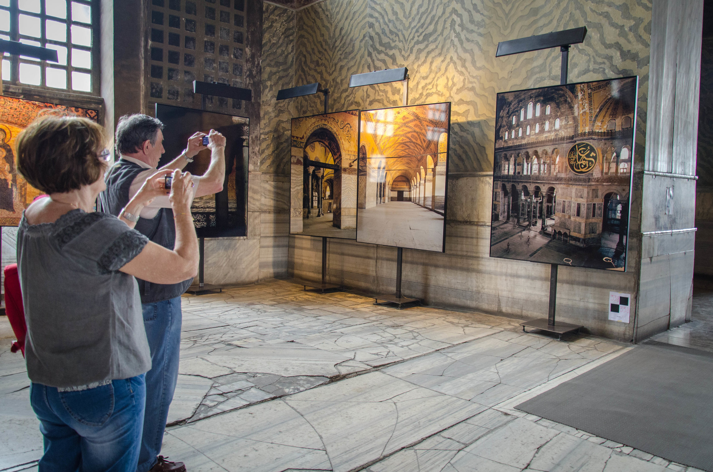 A photograph of people taking a photograph of a photograph of the Hagia Sophia in the Hagia Sophia. Istanbul, Turkey. Shot on DSLR (Nikon D7000).