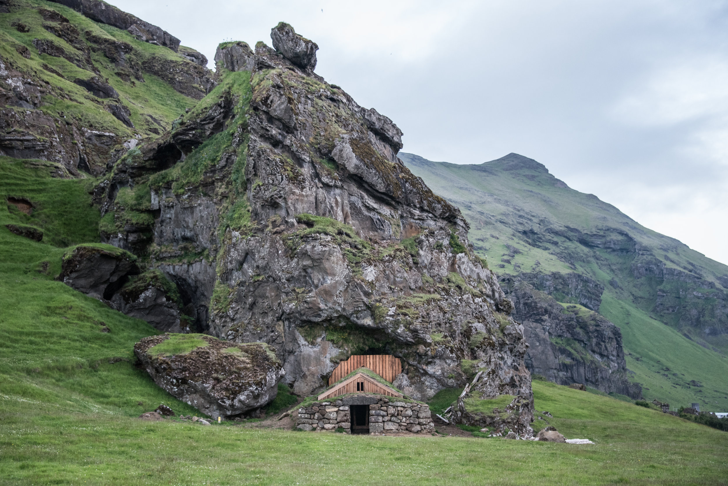 Icelandic huts were traditionally built into the earth for insulation. Livestock were kept on a lower level, and their body heat, radiating upward through widely-spaced floorboards, was used to heat the human inhabitants.