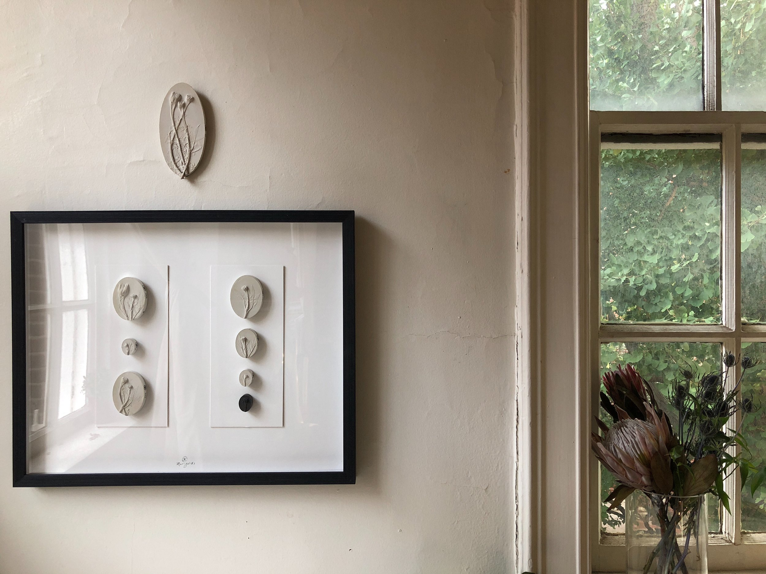 Purchase without the copper hooks in the back for easy framing.