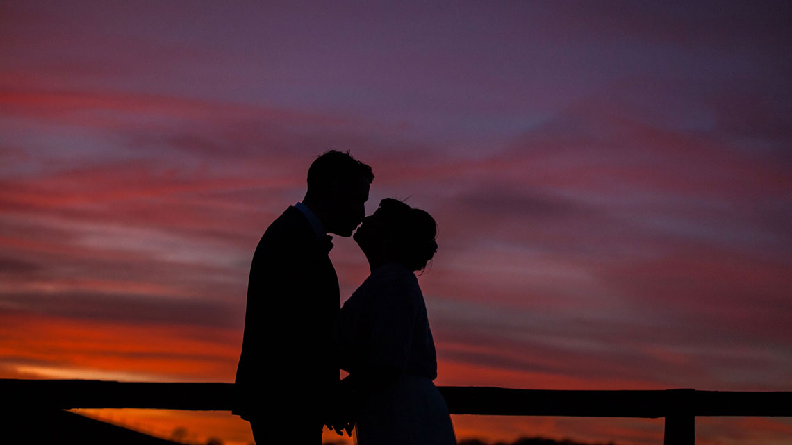 Long-furlong-barn-winter-wedding-sunset-silhouette.jpg