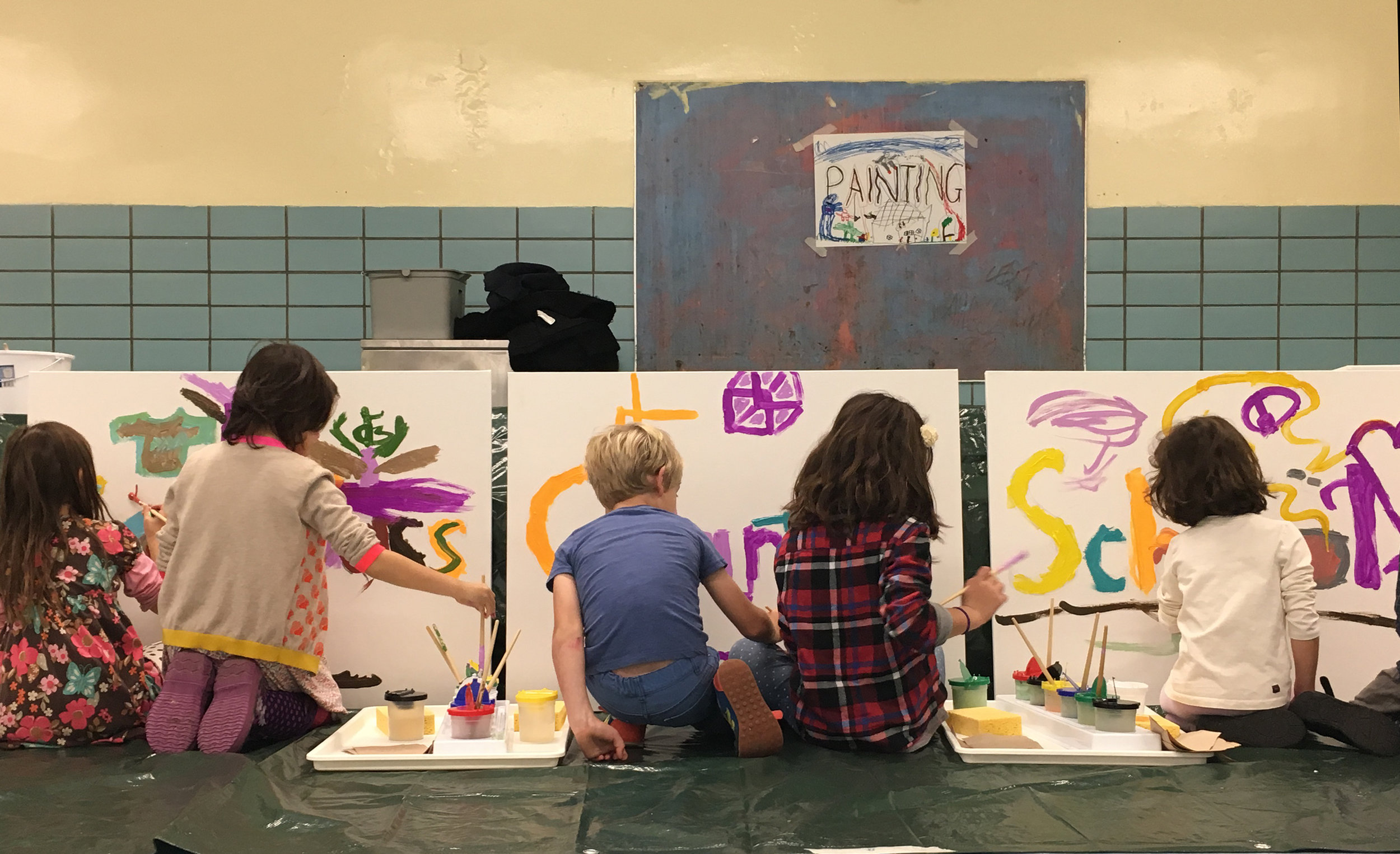 Kids painting the Compass mural at the 2016 FSC Fall Festival.