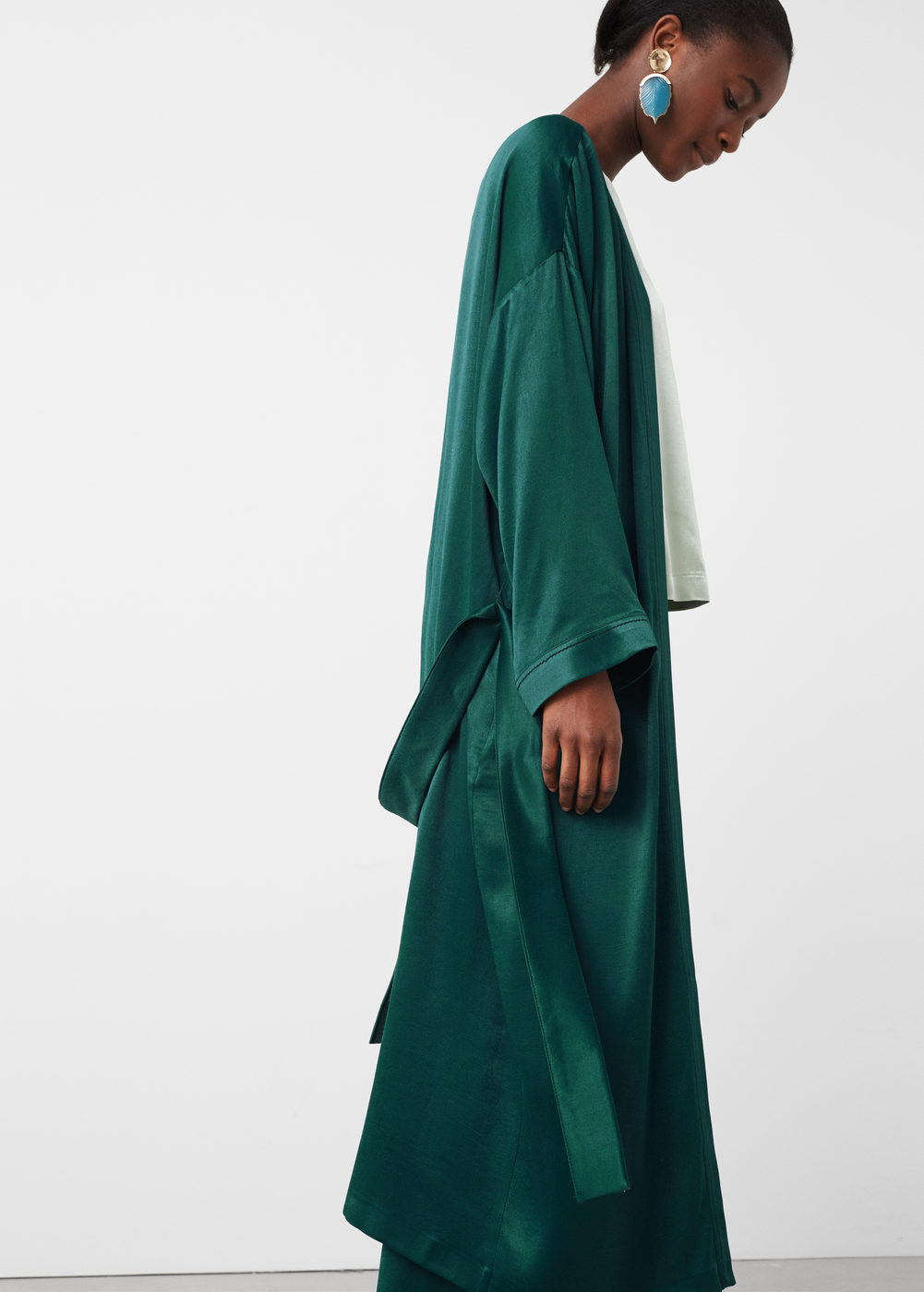 This silk robe   is amazing and the I'm also loving the green color. I can totally see myself lounging around in this or going out in it paired with a nice tailored pant. I can imagine the amount of stares already.