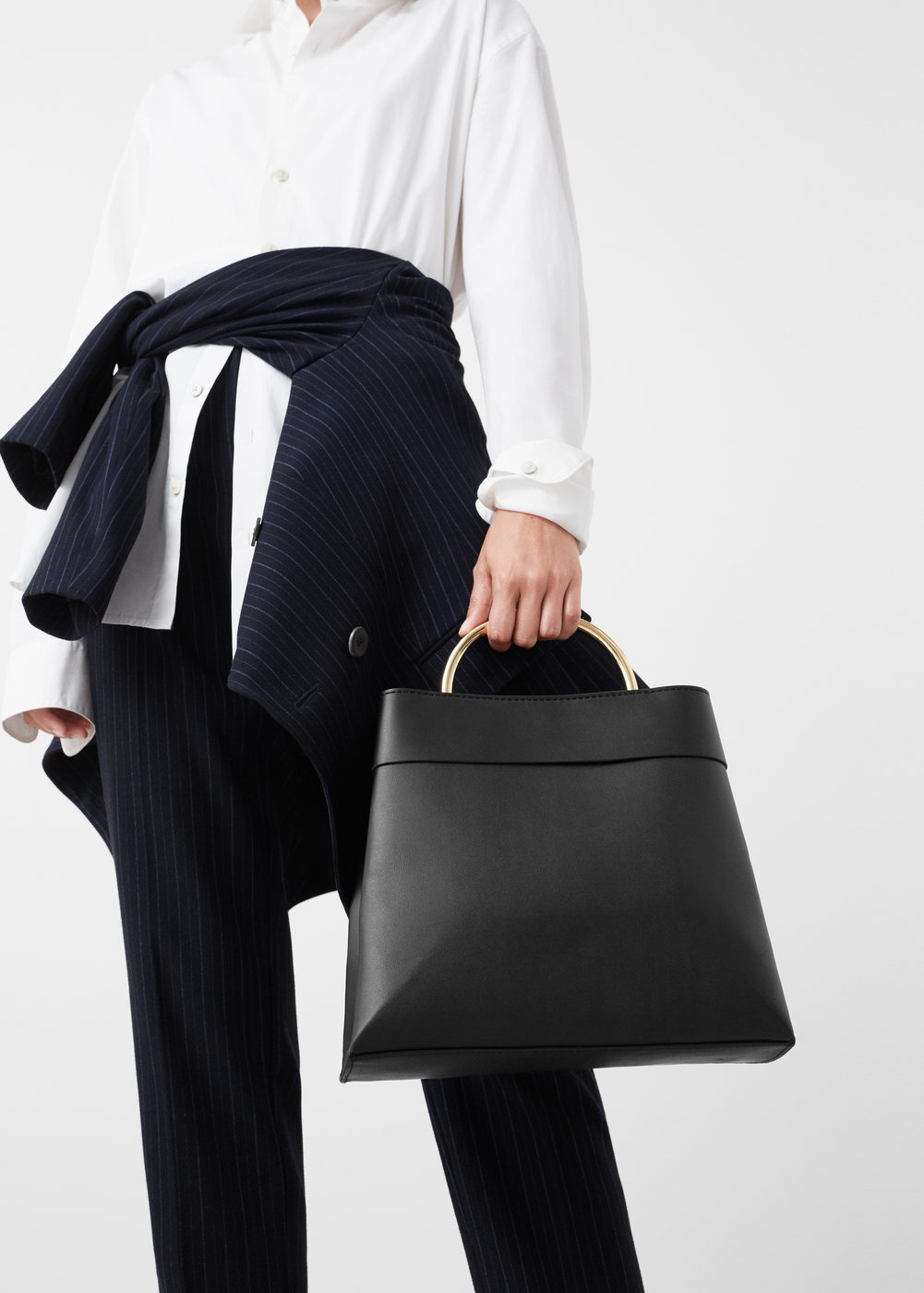 This bag   is so simple, yet so artfully designed. A must have.