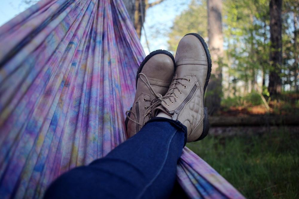 Person relaxing in hammock