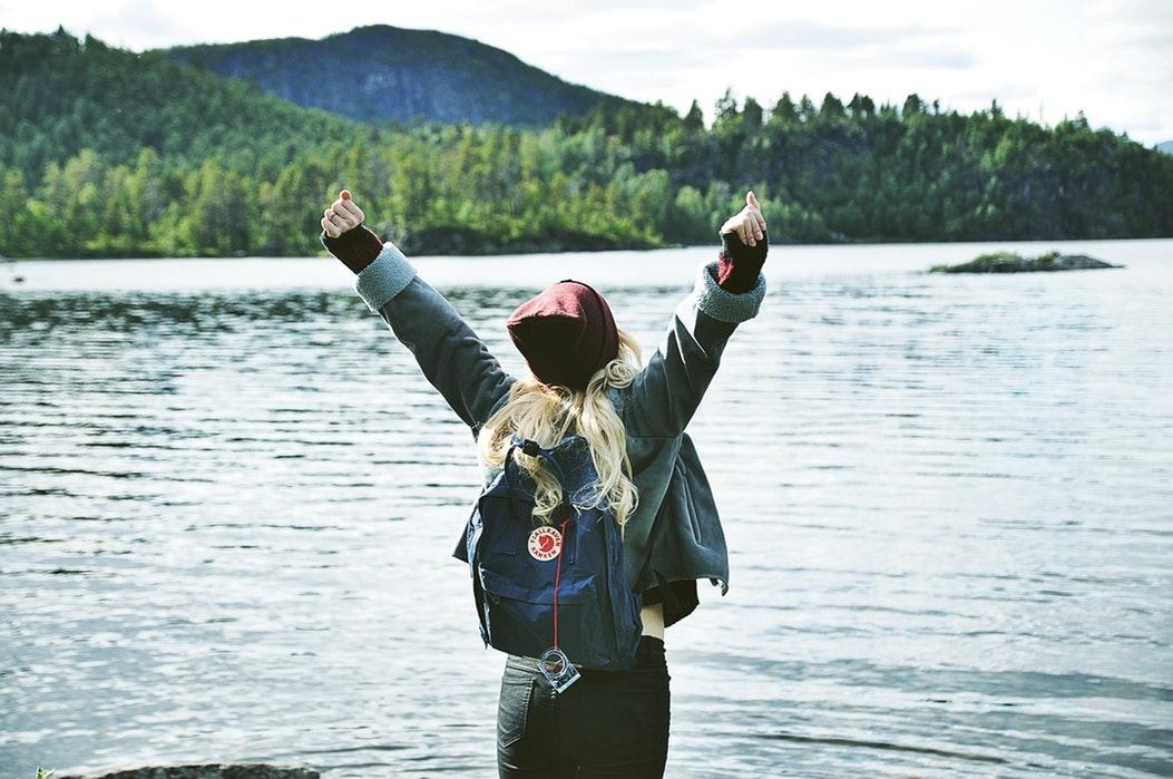 Girl by a lake