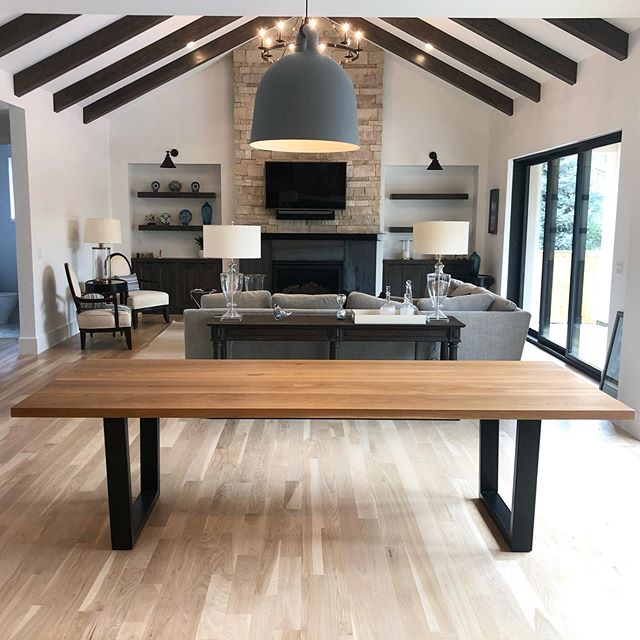 Our White Oak dining table with powder coated tapered steel legs ✨ Looks incredible in this absolutely stunning custom home