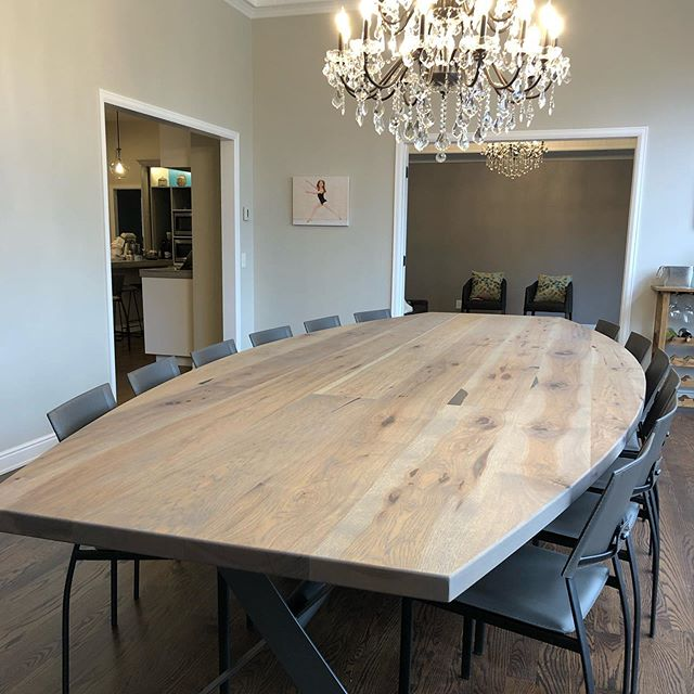 The new home for this 14' curved dining table in Cherry Hills. Made from rustic Hickory atop a 3 part x-base!
