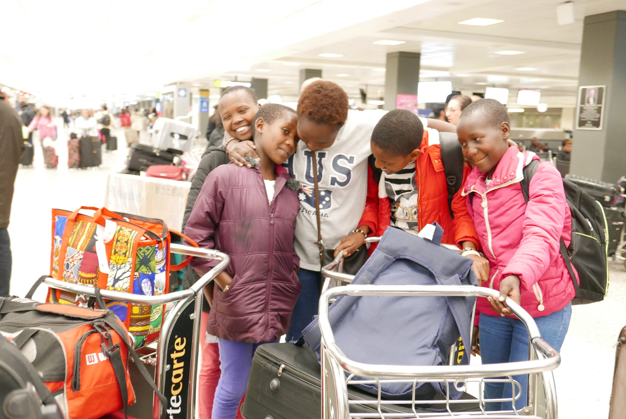 The girls are reunited with Kakenya at the Dulles International Airport in Virginia.