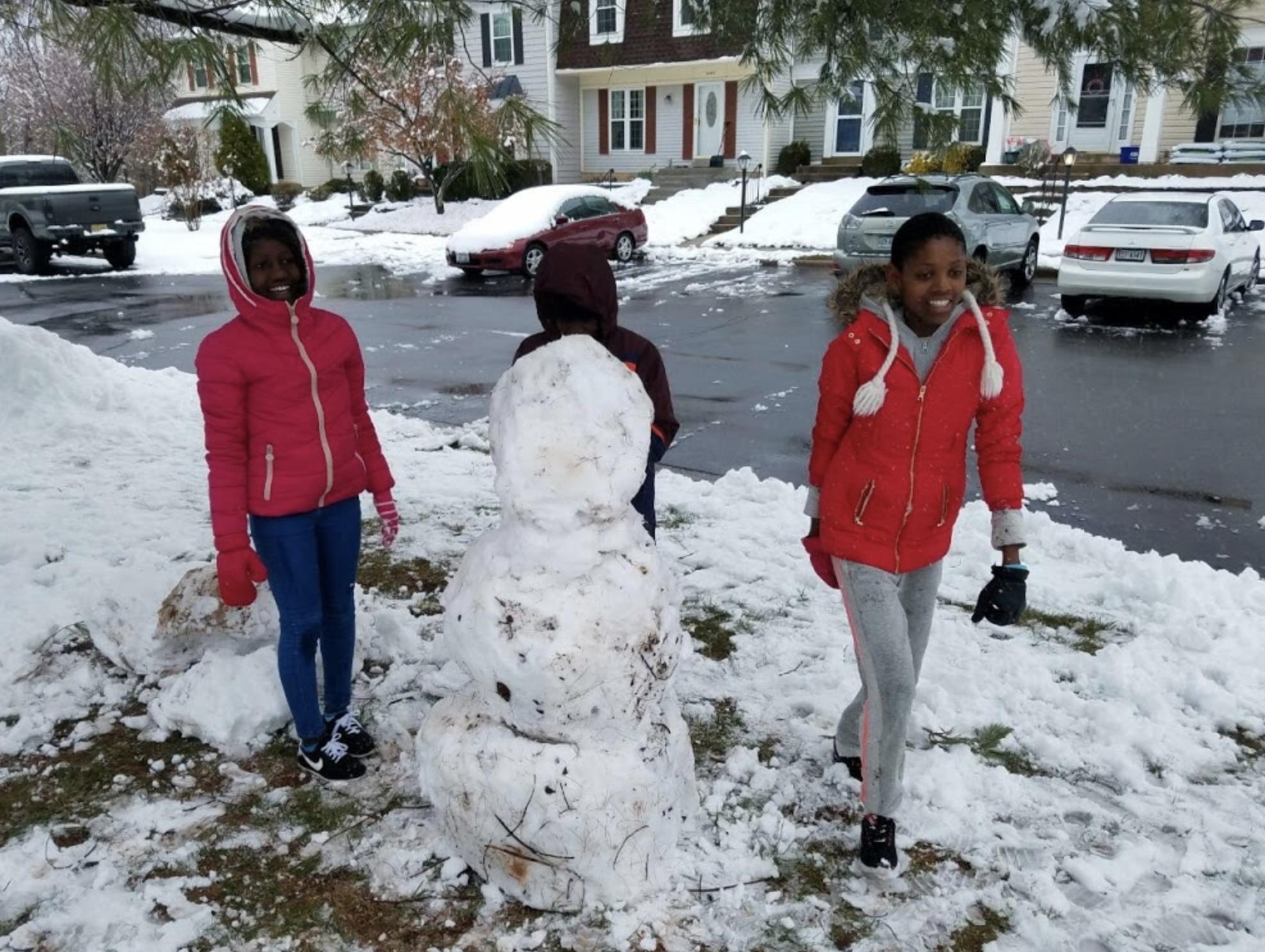 The girls build their first snowman!