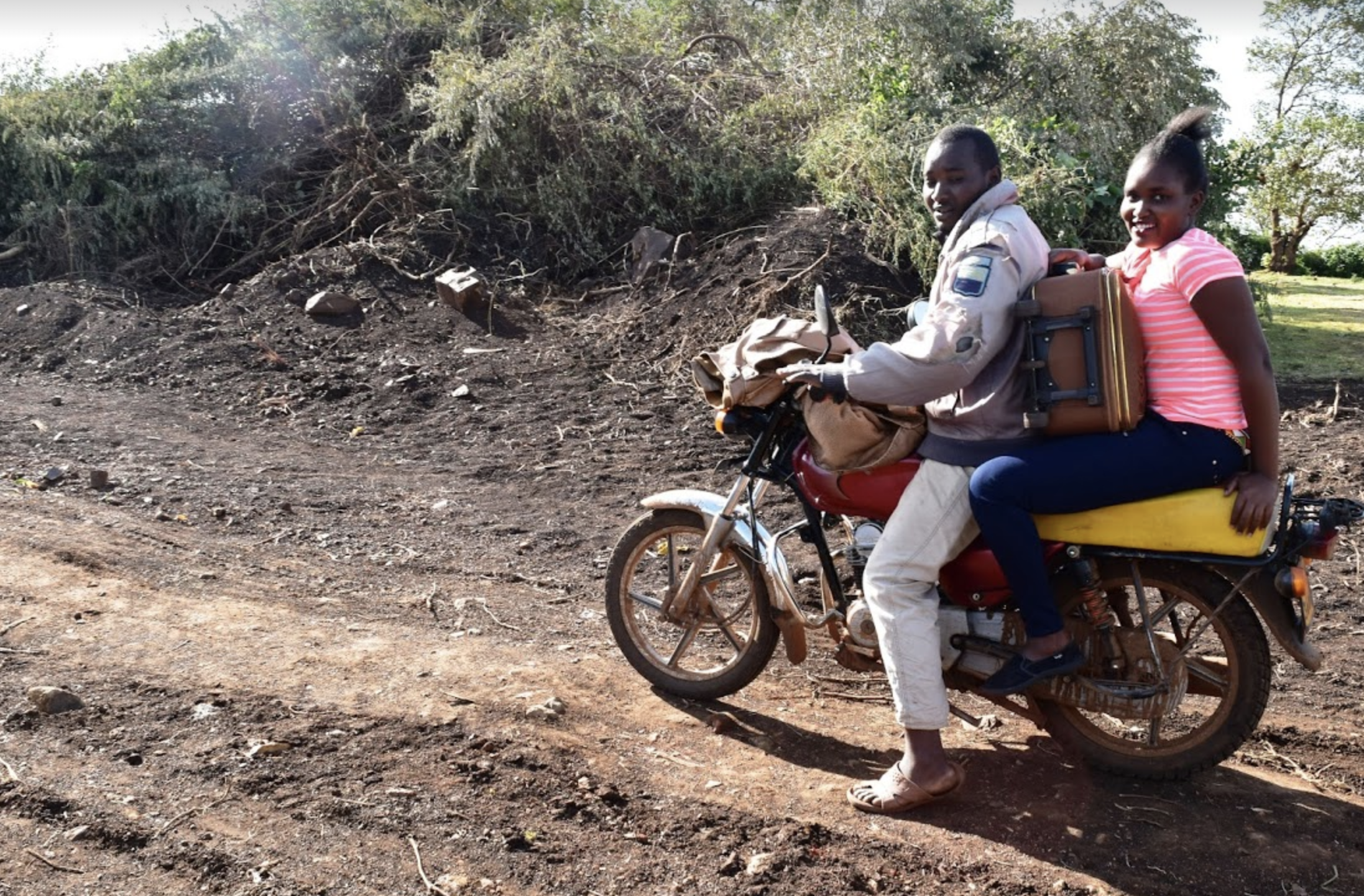 Linet takes a motorbike from her home, beginning the long journey to Australia