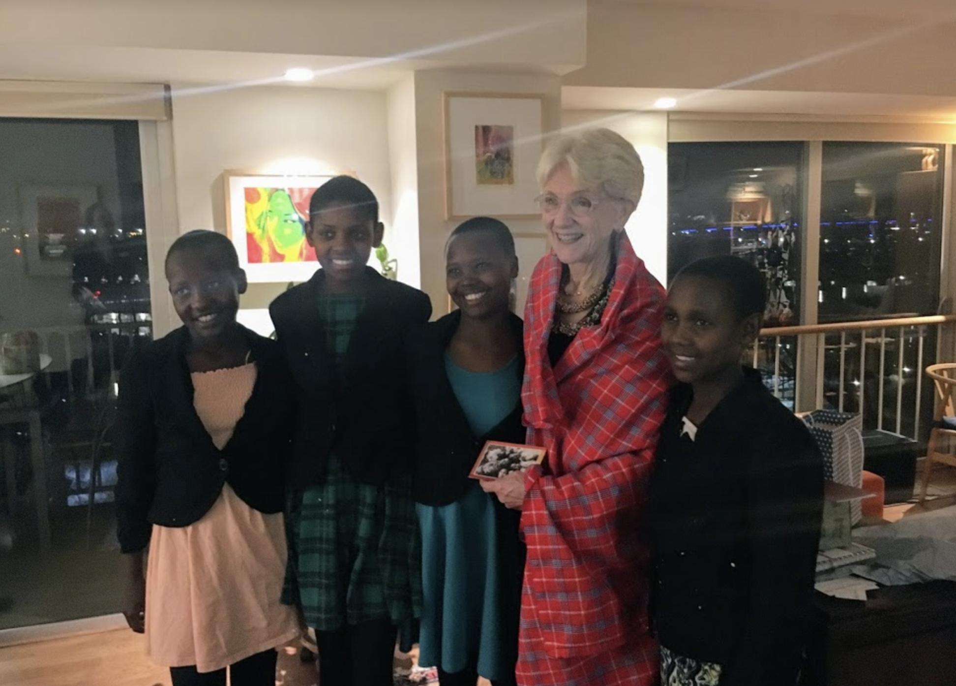 U.S. Board Chair Marlene M. Johnson with the girls