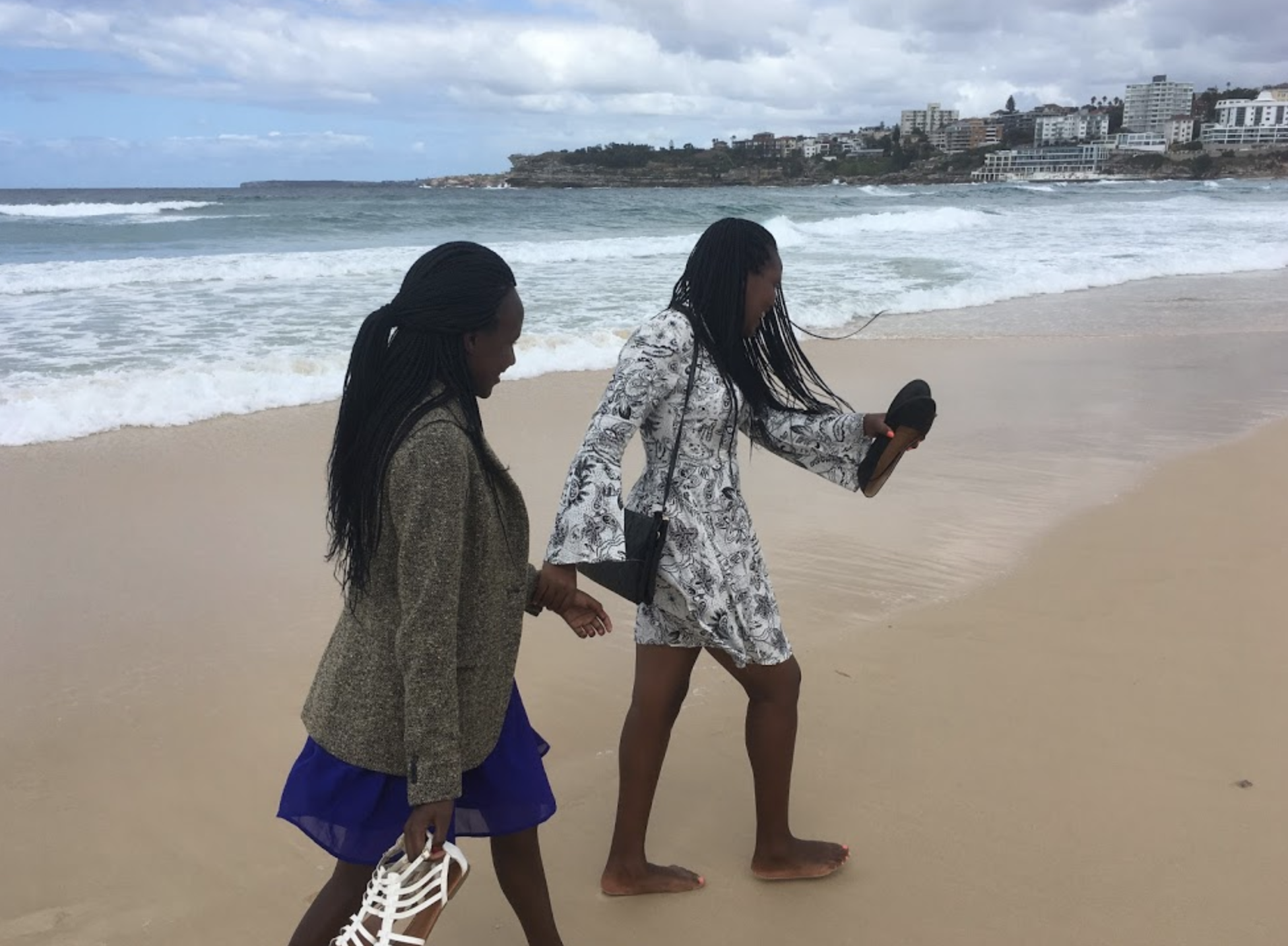 Linet and Sharon walk on the beach