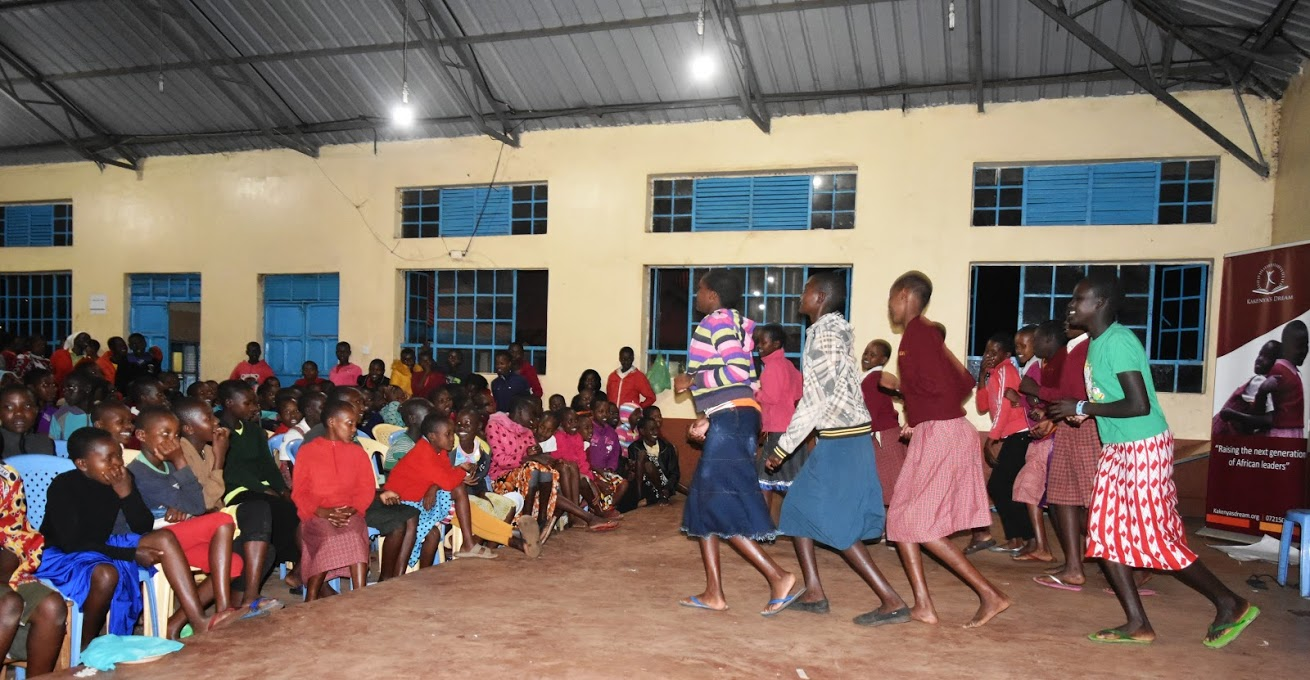 Girls participate in the talent show, which is always a highlight of the week.