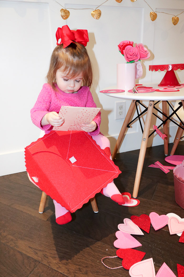 Live Love Blank www.liveloveblank.com Valentines day for Children Ideas Presents, red and Pink Hearts, Modern Eames Table and Chair set for child kids Perfect kids table tablescape for valentines day cake stand love sign, valentine card holder white table and chair set contemporary children dining table pink and red dress for little baby girls holiday ideas