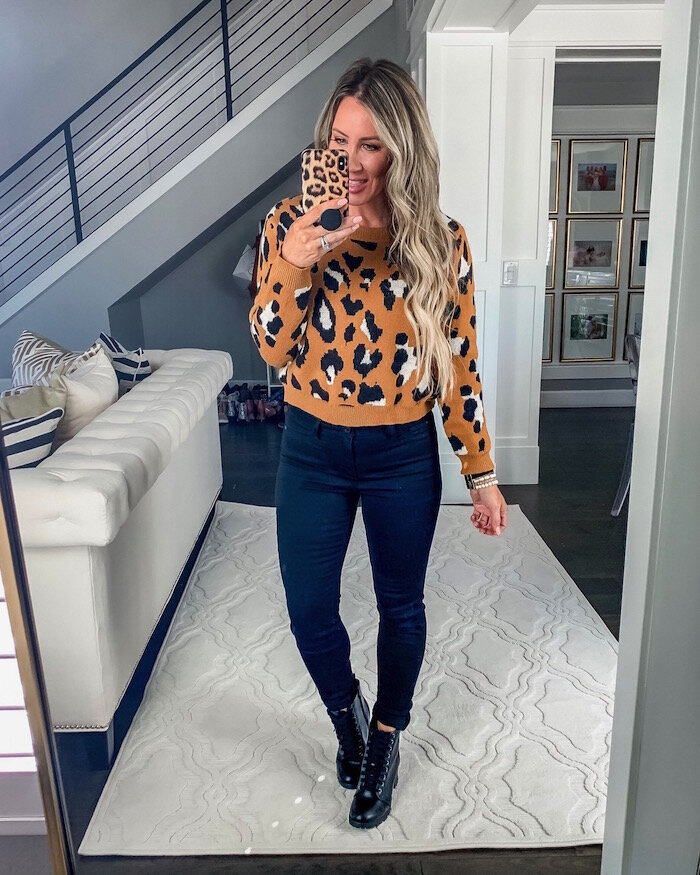 Walmart Fall Fashion Favorites featured by top US fashion blog, Live Love Blank: image of a woman wearing a Dreamers by Debut leopard pullover, No Boundaries crop jeans, Time and Tru Moto boots