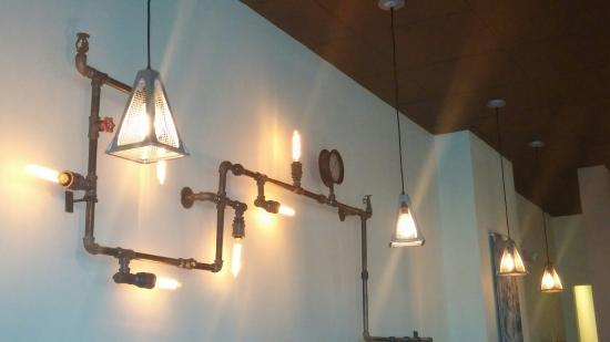Wire Mesh Jack Pendants & Pipe Sconce | On Forty-One | Mt. Pleasant, SC