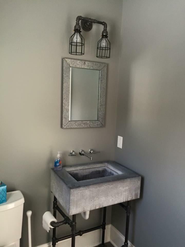 Pipe Sconce & Custom Concrete Vanity