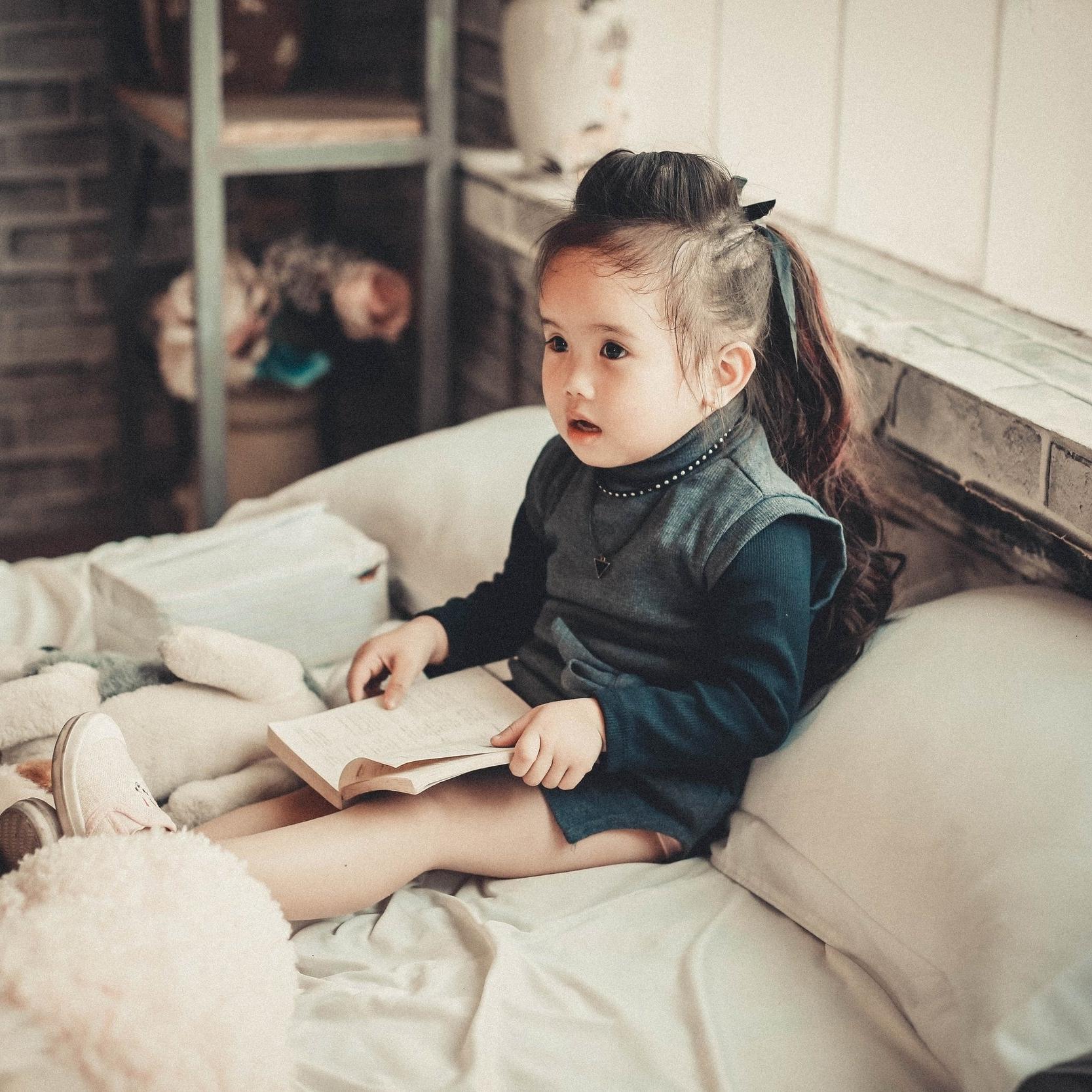 Girl Reading in Bed.jpg
