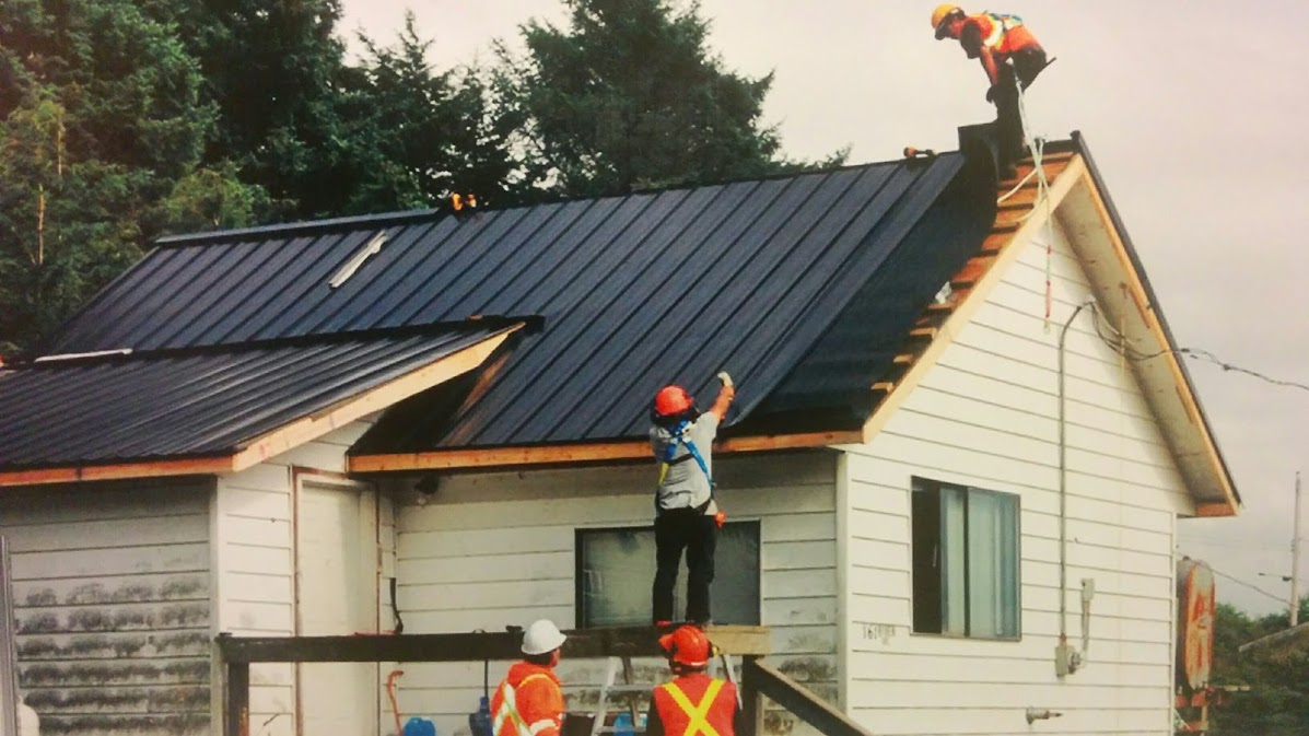 Old Masset Roofing Crew paced tin roof on nearly every home