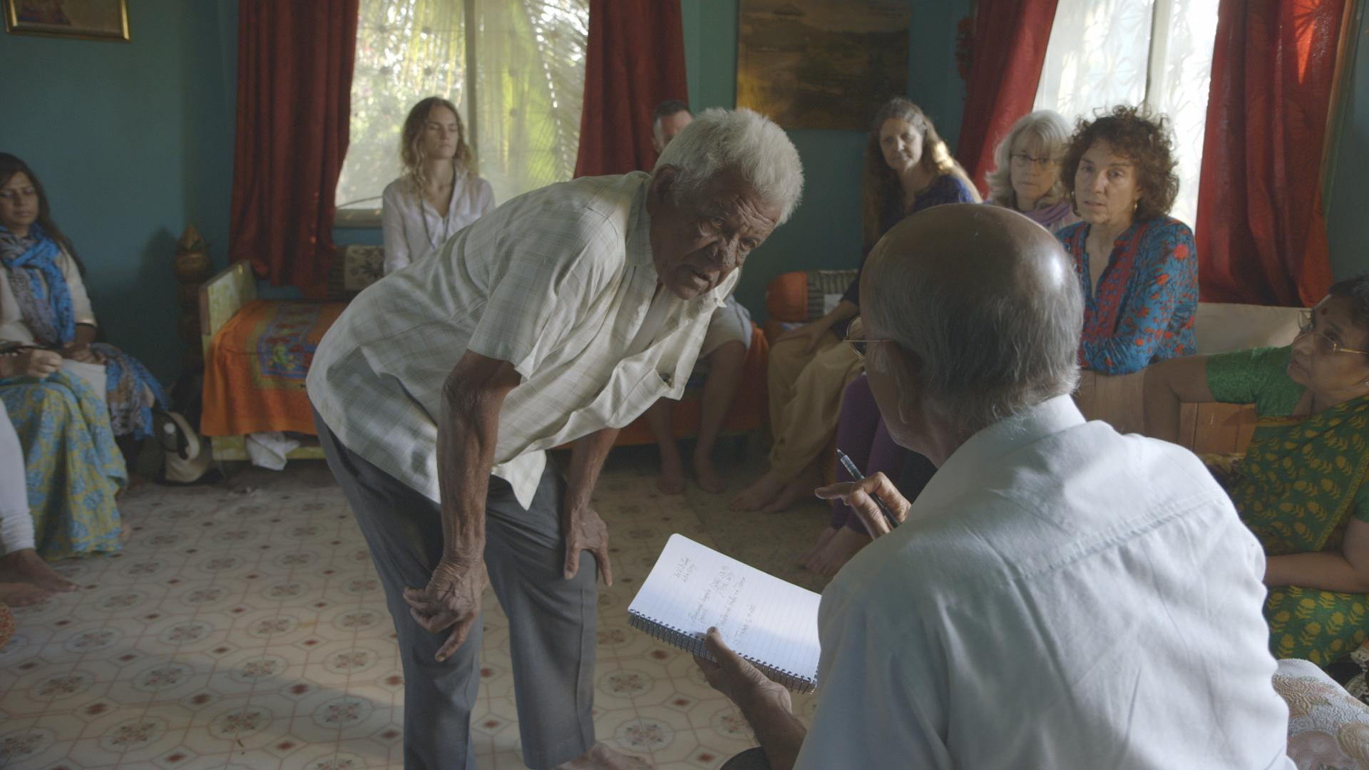 Dr. Lad seeing man from the local village while at his ancestral family home with students in Pune, India.