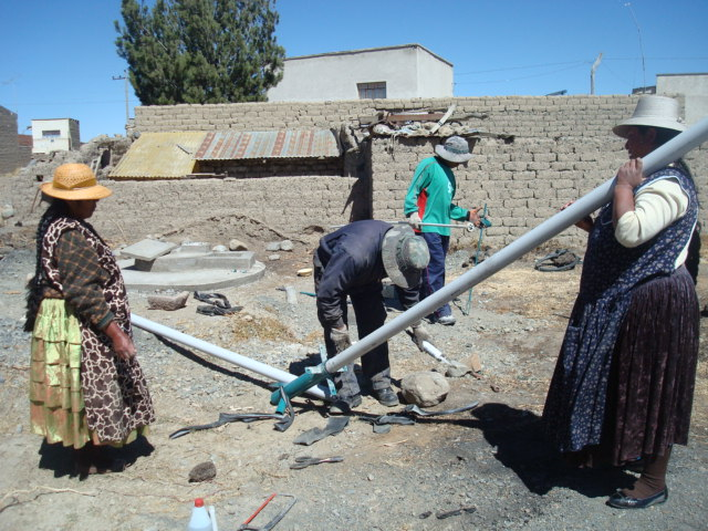 2010 07 Titin Jawira 1st Phase; SJ proposing 2nd Phase in 2011 - Local women helping install hand pumps.jpg