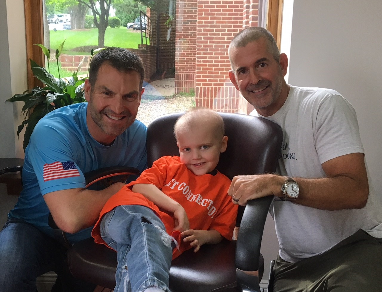 From Left: Hopecam Founder and 2X RAAM Competitor Len Forkas, 5 year old Hopecam kid Drew and Frank Fumich.