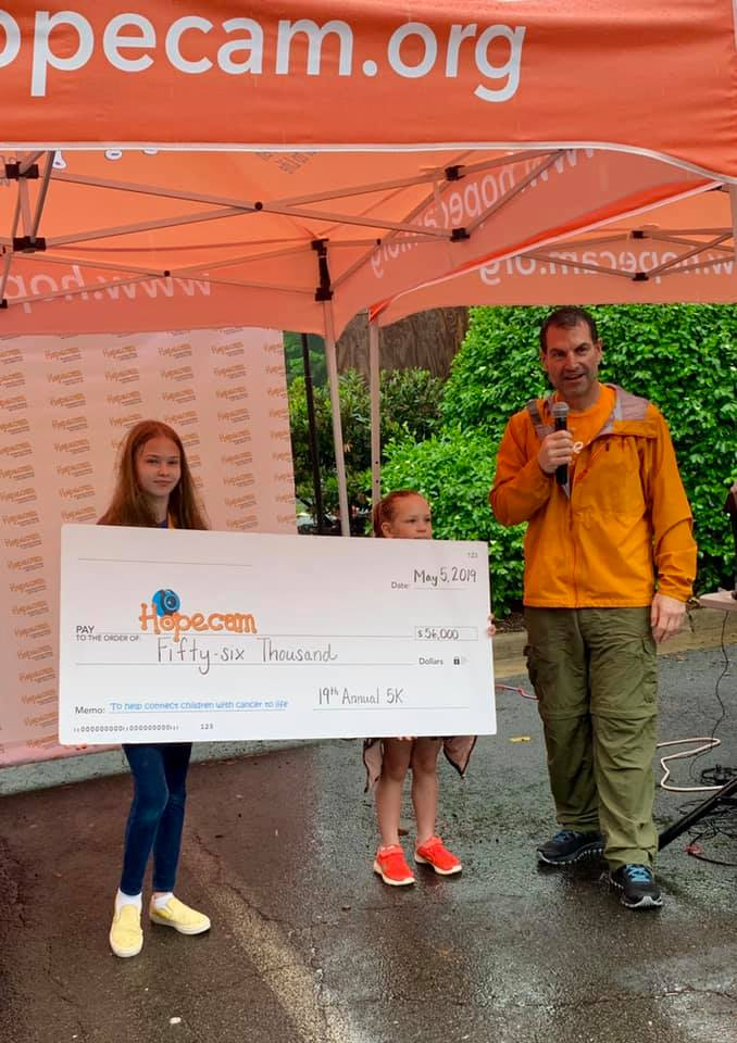 Hopecam Founder Len Forkas with Hopecam Alumni Children Ava and Lily, presenting the check!