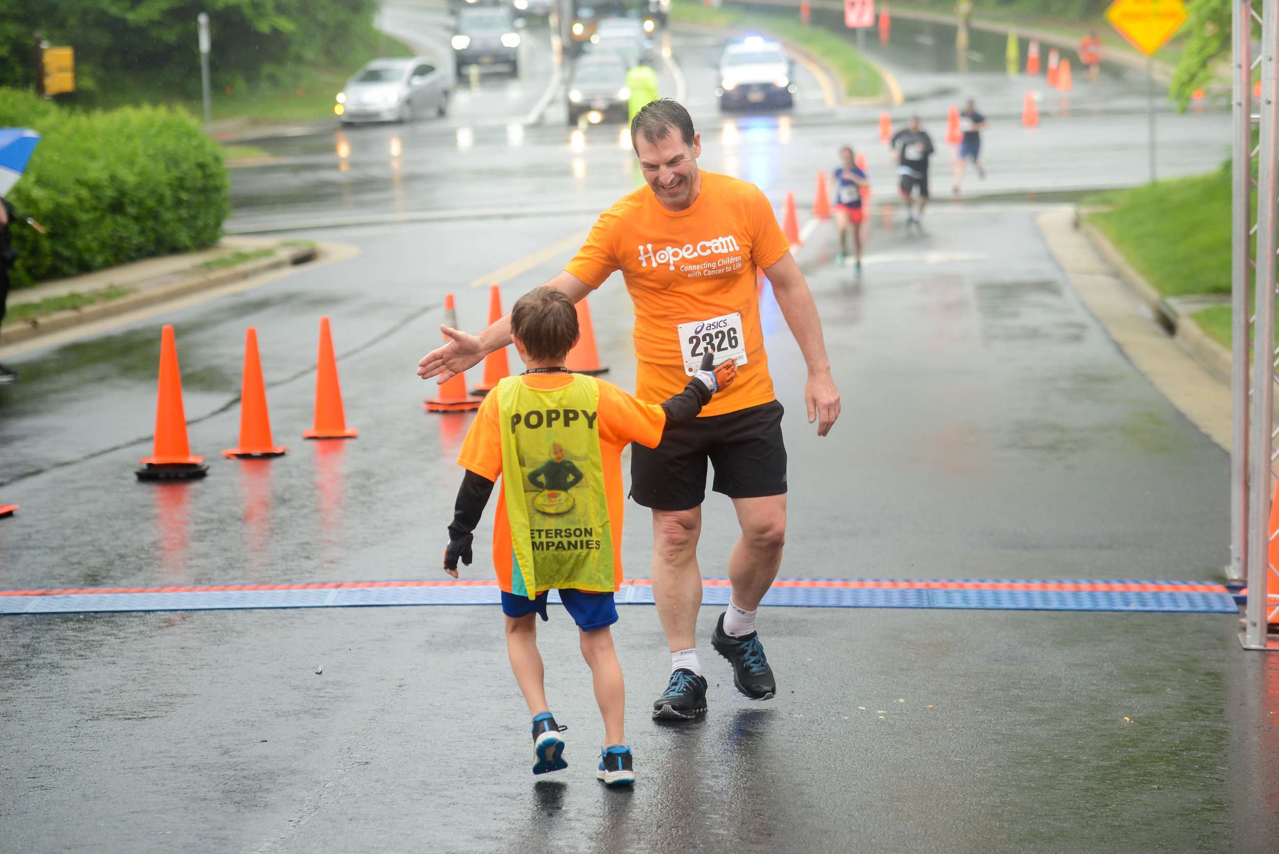 Matteo welcoming Len Forkas across the finish line. Matteo is running 100 miles to help connect more children with cancer! Visit  Matteo Runs  to learn more.
