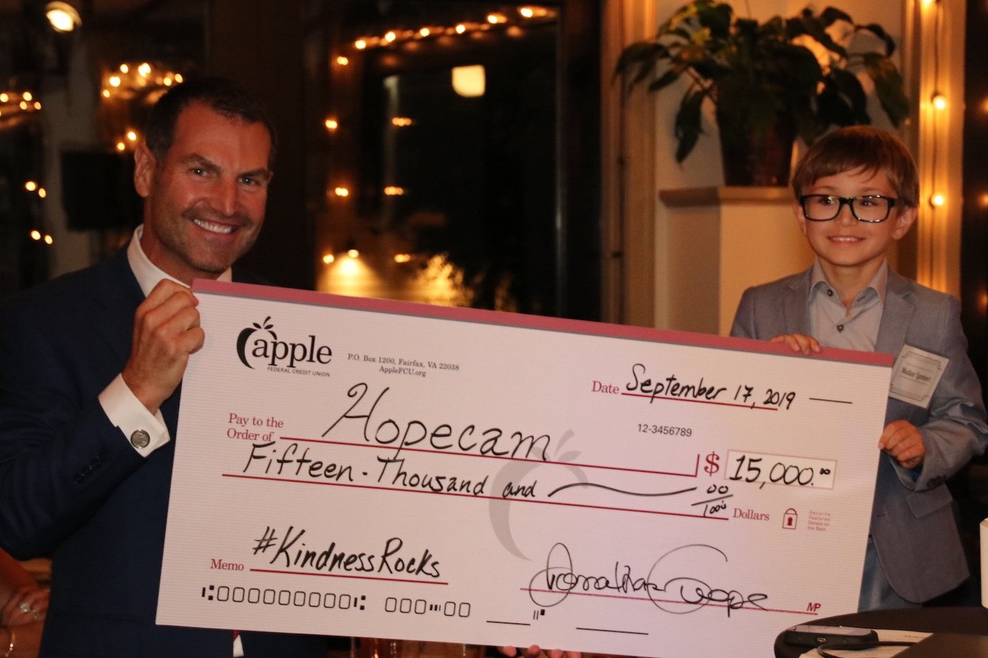 Len Forkas with Matteo and the $15,000 check to Hopecam from Apple Federal Credit Union