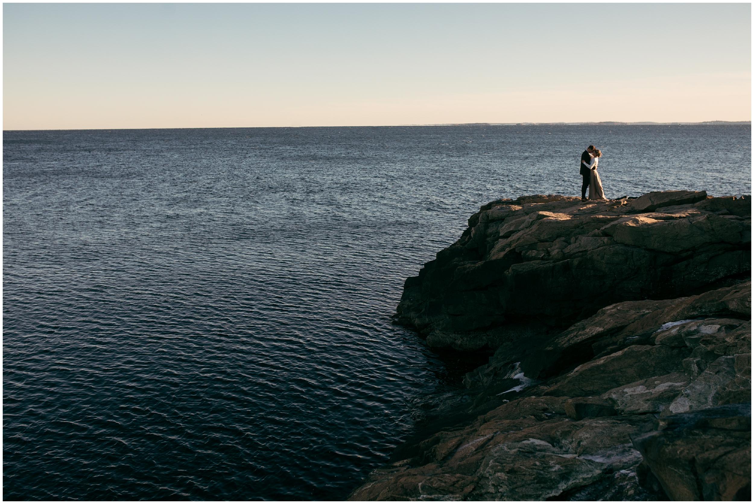 Sunset elopement on rocky coast of Massachusetts